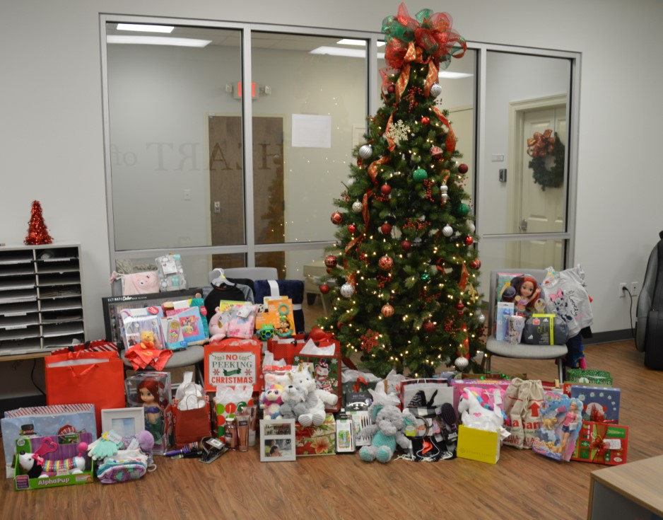 "Picture of donated toys underneath the ""Angel Tree"""